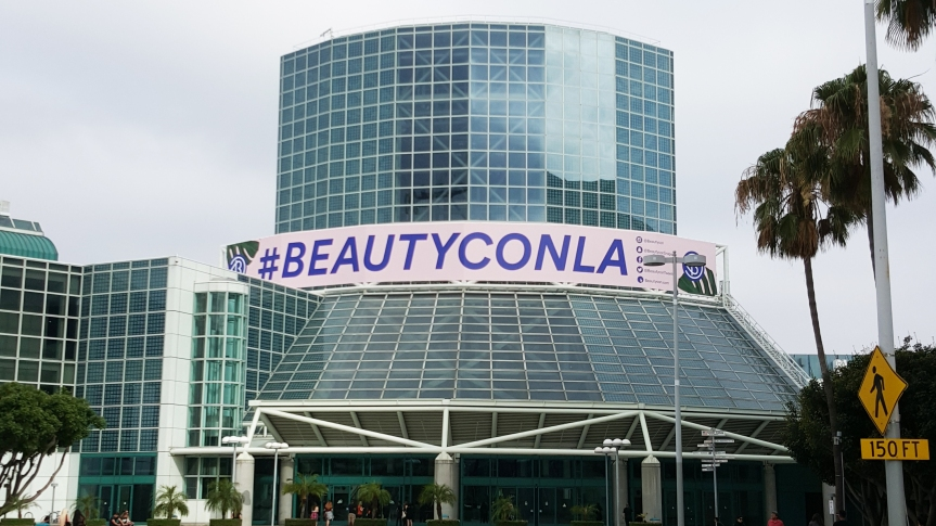 The pink banner marking our beauty oasis